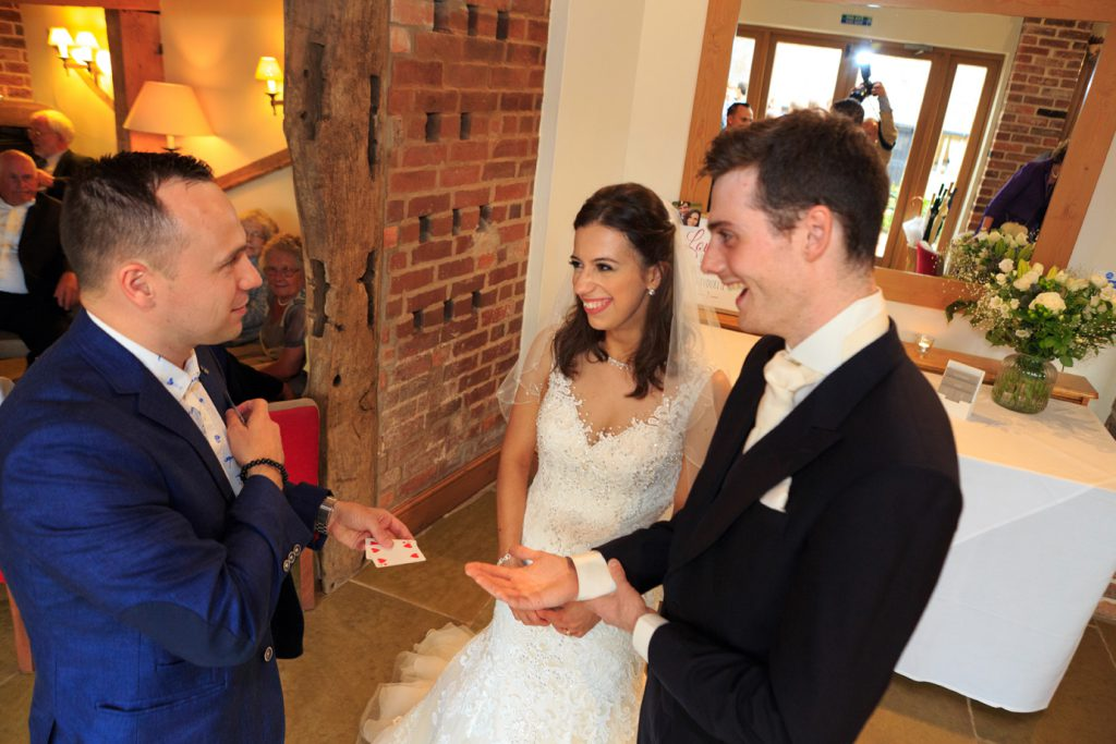 Performing Magic for the bride and groom